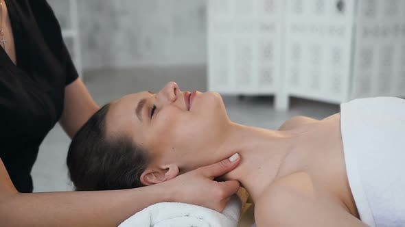 Thumbnail for Happy Young Woman Having Massage While Lying on the Massage Table