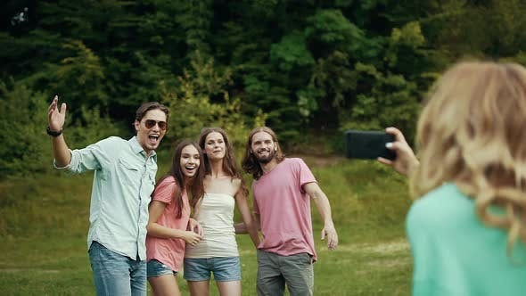 Happy Friends Taking Photos On Phone In Nature.