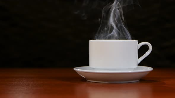 Thumbnail for Cup of Coffee Costs on a Wooden Table and Spreads a Pleasant Smell
