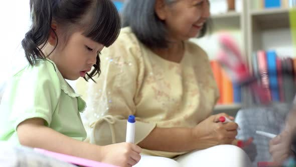 A Grandmother Teaching her Granddaughter 01