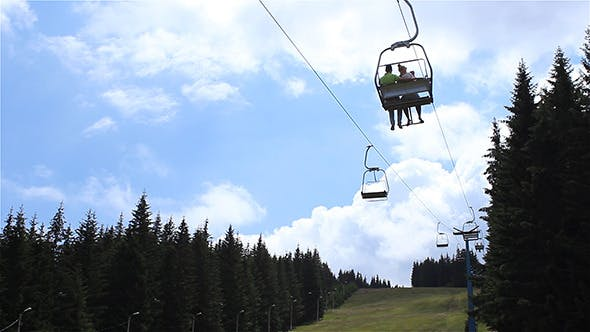 Thumbnail for Chairlift Over Fir Forest