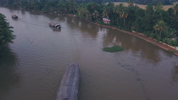 Houseboat tour of Kerala backwaters at Alleppey, India. Aerial drone view