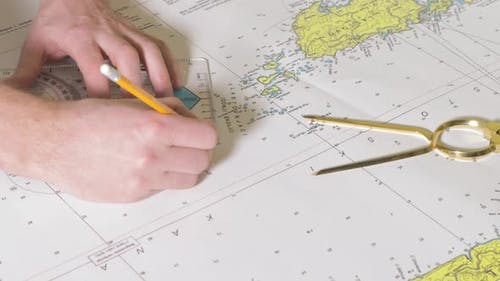 Man is Making a Course on the Nautical Map