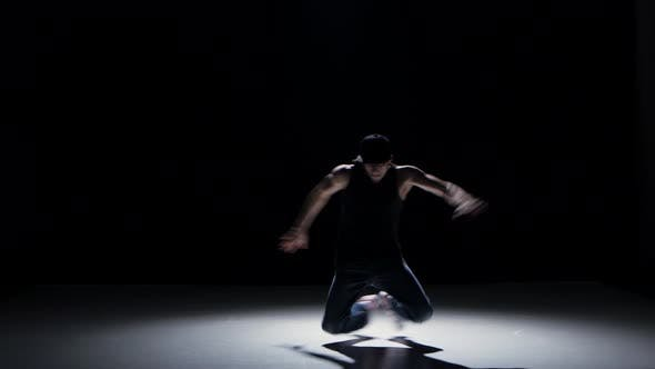 Thumbnail for Breakdance Dancer in Black Suit Starts Dance on Black, Shadow