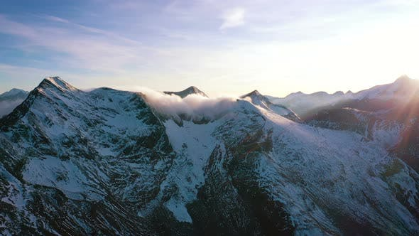 Thumbnail for Evening Aerial View Of Snowed Alps Summits