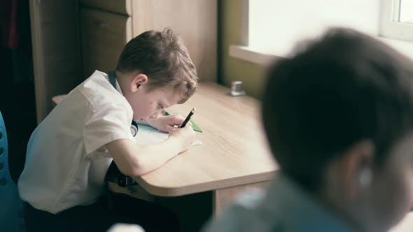 Stedicam Children Sit in Headphones and Do School Homework