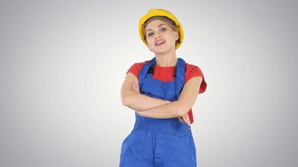 Thumbnail for Smiling constructor worker woman standing and changing