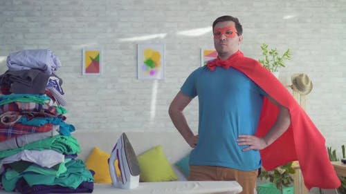 Portrait Man Householder Superhero Next To Ironing Board