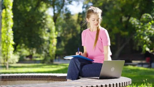 Students Studying with Laptop in Park