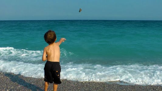 Thumbnail for Boy Throwing Stones To The Sea 2