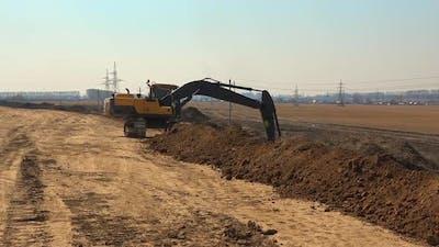 Excavator Shakes Ditch