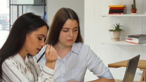 Thumbnail for Two Female Designers Working on a Laptop Together
