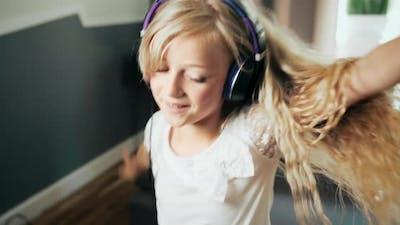 Teen Girl in Headphones Dancing