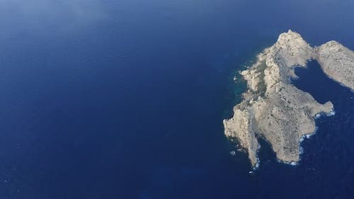 Ibiza Ocean Waters with Two Cliffs Apart