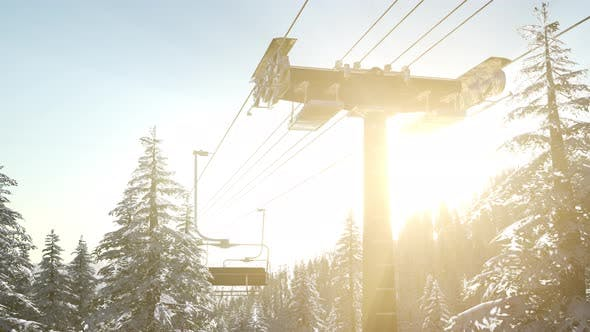 Thumbnail for Chairlift Silhouette on High Mountain Over the Forest at Sunset