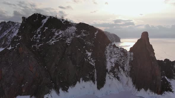 Aerial View of Winter Landscape of Rocky Mountains on Lake Baikal.