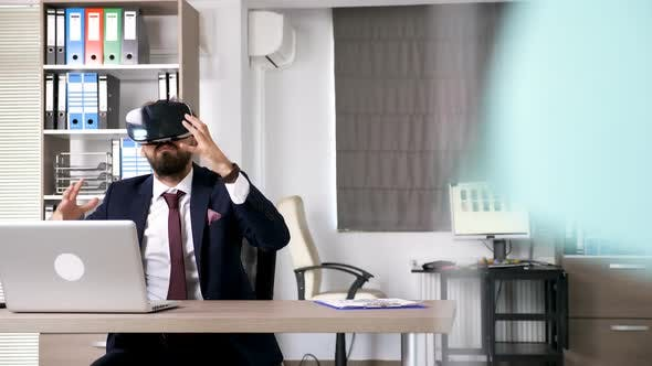 Thumbnail for Man in Business Suit Wearing a VR Headset
