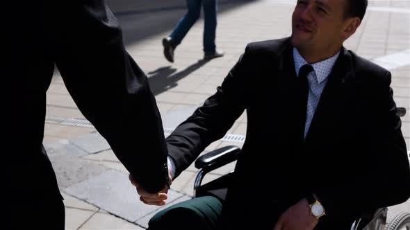 Thumbnail for Happy Entrepreneur Boss Shaking Hands With Invalid Businessman Outdoor