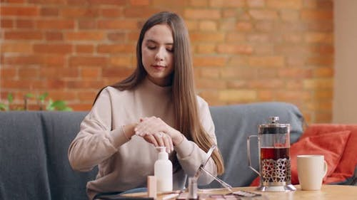 Young Millennial Woman Applying Moisturizing Cream Hands Enjoying Skincare Home Slow Motion