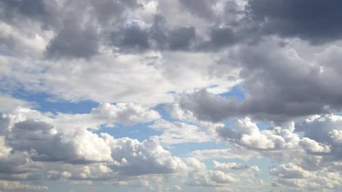 White And Gray Autumn Cumulus Rain Clouds Moving On Sky