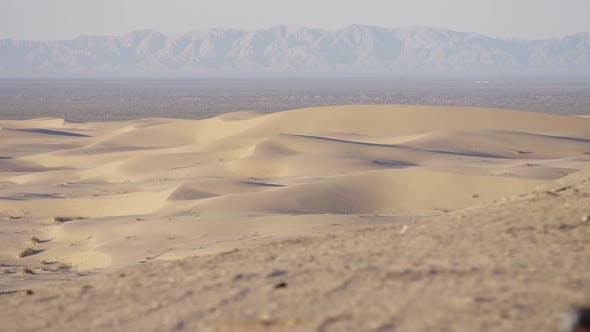 Thumbnail for Pan left view of sand dunes