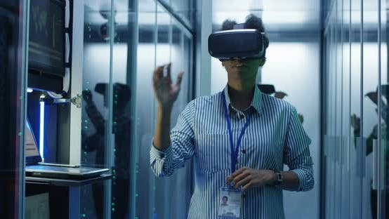 Thumbnail for Ethnic Woman in VR Glasses Working in Data Center