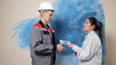 Handyman Counts Money and Shakes Hands with Woman Contractor