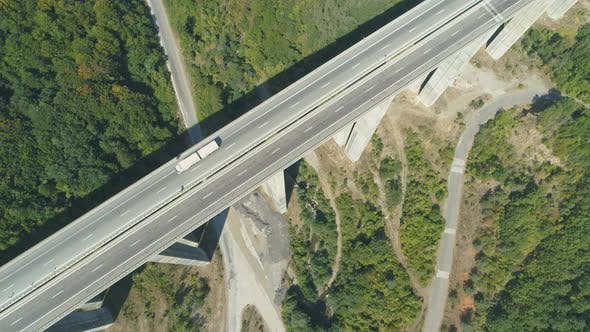 Thumbnail for Top View of Highway Bridge with White Truck Driving Along