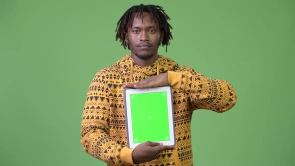 Thumbnail for Young Handsome African Man Showing Digital Tablet