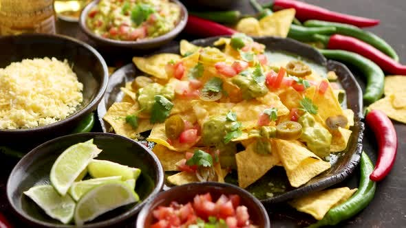 Thumbnail for Tasty Mexican Nachos Chips Served on Ceramic Plate