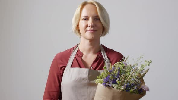 Thumbnail for Modest Blonde Florist Posing With Bouquet