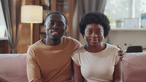 Portrait of Happy African American Couple on Sofa