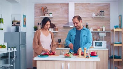Couple Cutting Fresh Vegetables