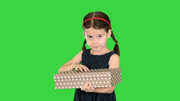 Thumbnail for Happy Girl in Black Dress Shaking and Opening Gift Box Smiling at Camera on a Green Screen, Chroma