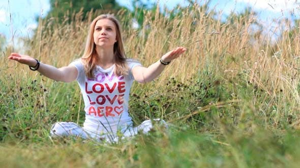 Thumbnail for Young Girl in White Meditating in the City Park