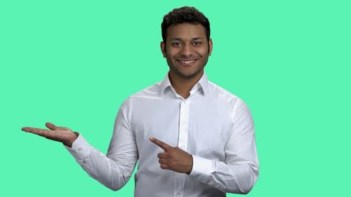 Smiling Businessman Presenting Place for Your Text or Product