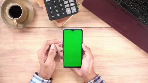 Flat Composition of Hand Using Smart Phone on Office Desk