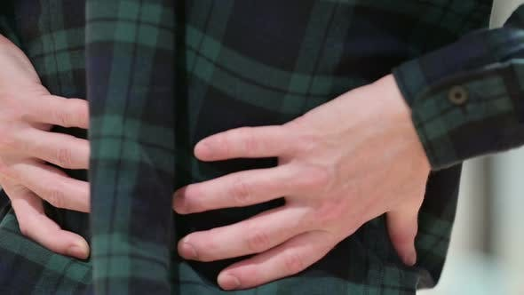 Close Up of Man with Back Pain Holding Back