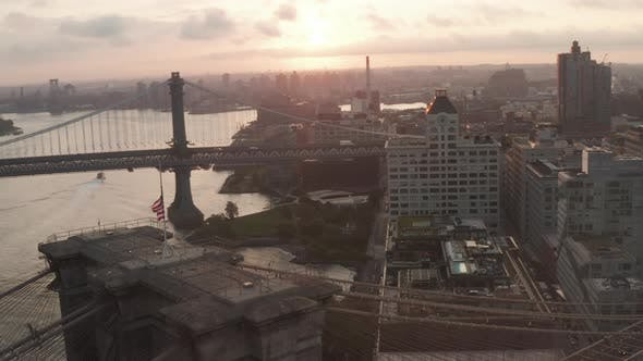 Thumbnail for Close Up of Brooklyn Bridge with American Flag and Beautiful Sunrise Morning Light Over East