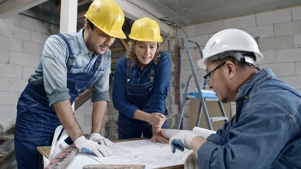 Thumbnail for Construction Workers Discussing Floor Plans