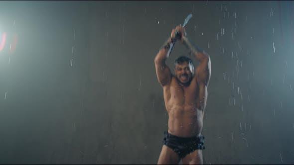 Thumbnail for Shirtless Gladiator Jumping in Attack Under Rain.