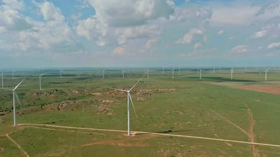 West Texas Field of a Larger Wind Farm with Panoramic View Wind Blade Generators