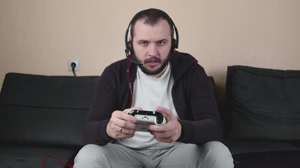 Angry Man Gamer with Headset Play Online Team Video Game, Live Streaming