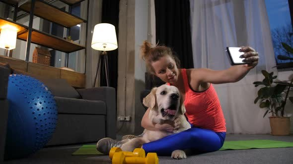 Sporty Woman Aking Selfie Photo with Pet Dog