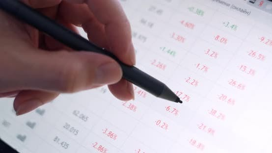 Thumbnail for Stock Market, The Trader Moves the Stylus on the Screen and Views Stock Quotes.