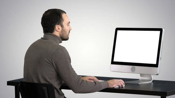 Cover Image for Businessman Working with A Computer on Gradient Background.