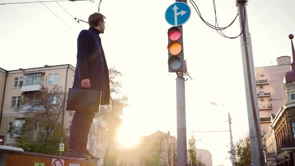 Thumbnail for Young Business Man Takes Step Towards Success When the Traffic Light Turns Green