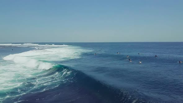 Group of Surfers Doing Surf Stunts and Enjoys Riding the Waves on Summer.
