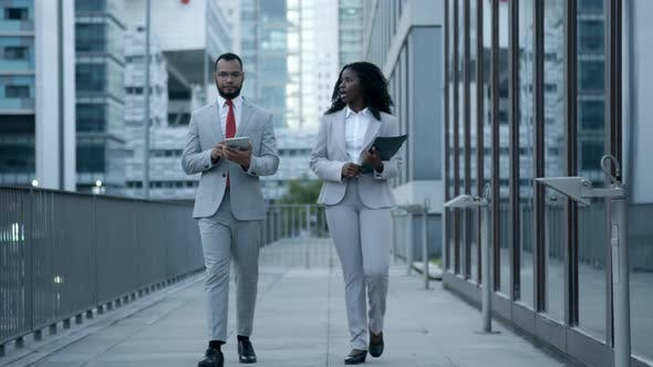 Thumbnail for Confident African American Managers Walking on Street and Talking
