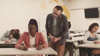 Professor Checking on Students on Exam